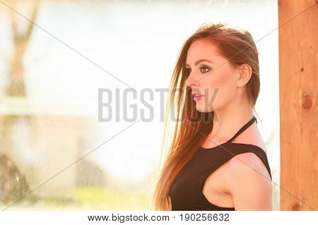 Young Fashionable Woman Posing During Sunny Day.