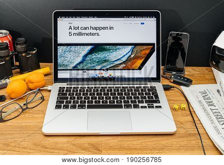 PARIS FRANCE - JUNE 6 2017: Apple Computers website on MacBook Retina in creative environment showcasing latest news from Apple at WWDC 2017 - 5mm computer bezel imac pro