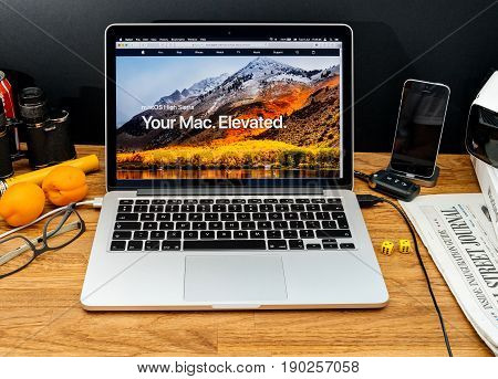 PARIS FRANCE - JUNE 6 2017: Apple Computers website on MacBook Retina in creative environment showcasing latest macOS High Sierra from Apple at WWDC 2017 - presentation of the new operating system