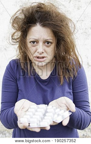 Anxious and desperate girl with pills medical