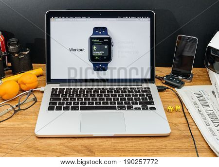 PARIS FRANCE - JUNE 6 2017: Apple Computers website on MacBook Retina in creative environment showcasing latest WatchOS 4 at WWDC 2017 - apple workout tracker
