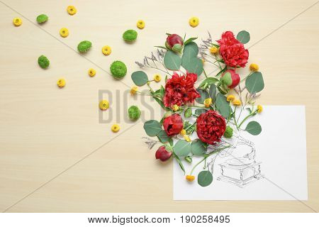 Composition of beautiful flowers and drawn phonograph on paper. Creativity concept
