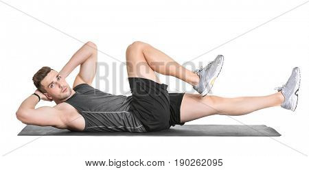 Handsome man doing bicycle crunch on white background