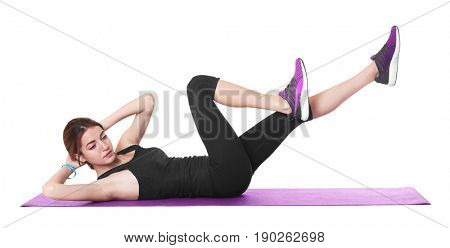 Beautiful woman doing bicycle crunch on white background