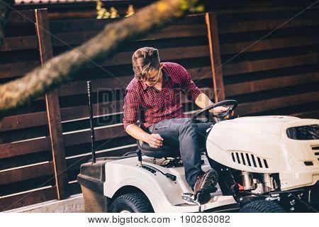 Professional Gardner Riding Lawn Mower - Landscaping And Gardening Details