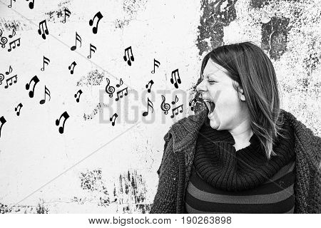 Woman singing with musical notes symbol music