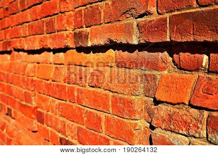 red brick wall with focus in the foreground