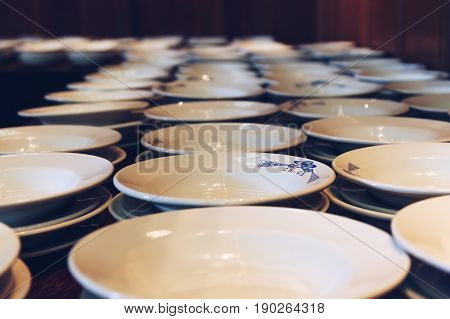 OXFORD, UK - MAY 22, 2017: Plates lined up for dinner at The Great Hall of Christ Church College. The Hall was replicated at film studios as the grand dining hall at Harry Potter's Hogwarts school.