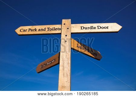 lulworth cove and Durdle door wooden sign with lovely sky