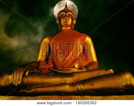 Statue of Buddha in the night. Meditation concept. Wat Yai-Suwanaram Phetchaburi Thailand.