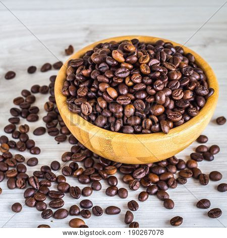 Coffee Beans In A Wooden Plate