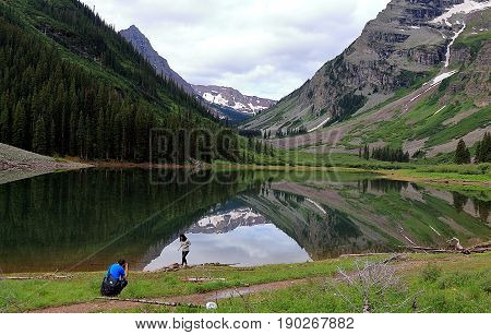 Maroon Bells Aspen Colorado - July 7, 2016 . A couple taking pictures at scenic landscape of Maroon Bells