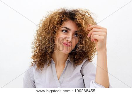 Young Woman Looking At Split Ends In Hair