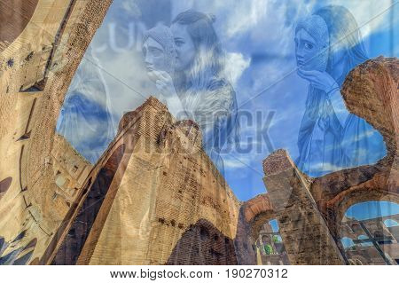 ALBA IULIA ROMANIA - APRIL 29 2017: Double exposure with fisheye view inside the Colosseum and young Roman girls in antical theatrical scene at APULUM ROMAN FESTIVAL organized by the City Hall.