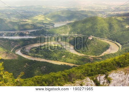 Ovcar Kablar Gorge, Serbia.   Meanders of  West Morava river,  view from the top of the Kablar mountain. Dramatic morning lights and shadows in springtime