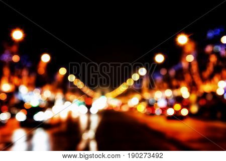 defocused lights of the street - Elysian Fields Paris Arc de Triomphe in the background