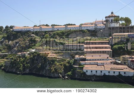 PORTO, PORTUGAL - AUGUST 7, 2015: Wineries below the Monastery of Serra do Pilar World Cultural Heritage by UNESCO seen from Porto in Gaia Portugal.
