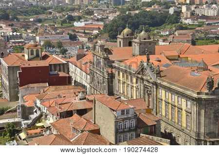 PORTO, PORTUGAL - AUGUST 7, 2015: A view of the city and wineries of Gaia at the other side ot the river from Clerigos Tower in Porto Portugal