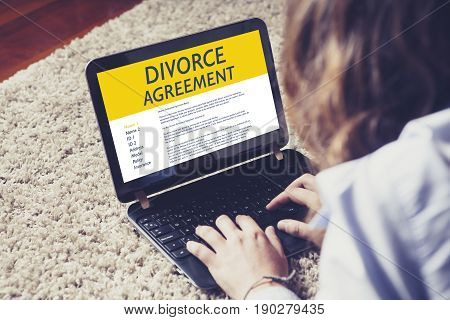 Divorce Agreement concept: Laptop computer with Divorce Agreement in the screen.