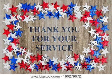 Thank You For Your Service text with red white and blue stars on weather wood