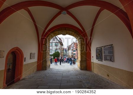 Bamberg, Germany - February 19, 2017: Bamberg city center street view with arch and people