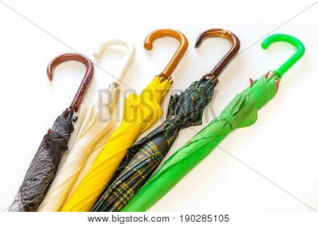 Creative image of umbrellas of different colors on a white background