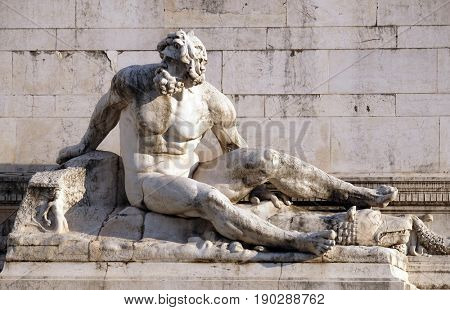 ROME, ITALY - SEPTEMBER 01: The statue at the fountain that represents the Tyrrhenian Sea, Altare della Patria, Venice Square, Rome, Italy  on September 01, 2016.