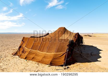 Tent In  The Desert Of Morocco Sahara And Rock  Stone    Sky
