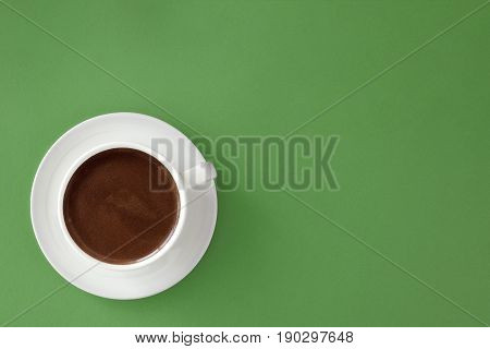 Coffee In White Cup On Green Background.