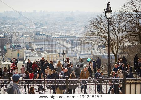Paris - March 11: People Enjoying Beautiful City View From Observation Point On Montmartre Hill On M