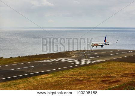 Funchal - March 24: View Of Runway With Landing Plane In Cristiano Ronaldo International Airport On