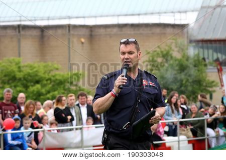 Beaulieu, Hampshire, Uk - May 29 2017: Fire Dog Handler Of The Hampshire Arson Task Force Addressing