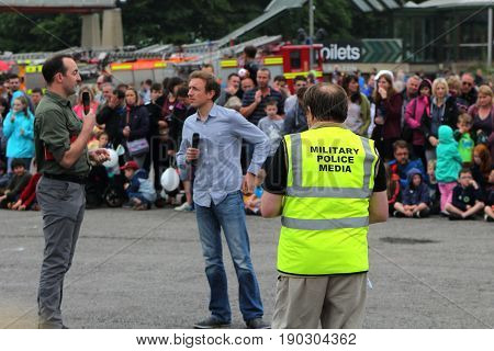 Beaulieu, Hampshire, Uk - May 29 2017: Compere Of The 2017 999 Show Interviewing A Participant, Watc