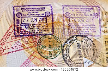 BRISBANE, AUSTRALIA - JUNE 3, 2017: Various arrival and departure stamps on a passport