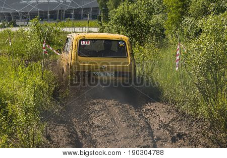 Lviv Ukraine - May 30 2015: Off-road vehicle VAZ-NIVA (No. 710) overcomes the track on of landfill near the city Lviv.