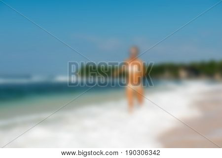 Young bikini babe at beach Bali Indonesia Travel theme creative abstract blur background with bokeh effect