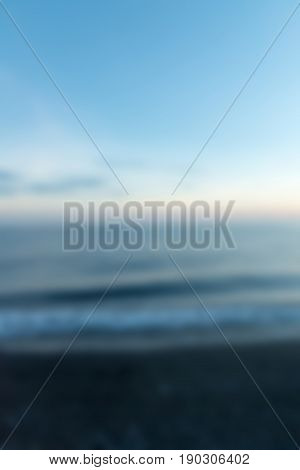 Amed Black Sand Beach Bali Indonesia Travel theme creative abstract blur background with bokeh effect
