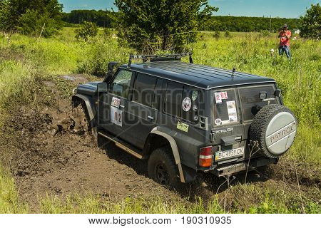 Lviv Ukraine - May 30 2015: Off-road vehicle Nissan Patrol overcomes the track on of landfill near the city Lviv.