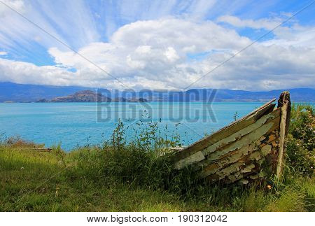 Boat on shore of General Carrera Lake with islands, Patagonia, Chile