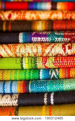 OTAVALO, ECUADOR - MAY 17, 2017: The typical andean fabrics sold on the handicrafts market of Otavalo, Ecuador.