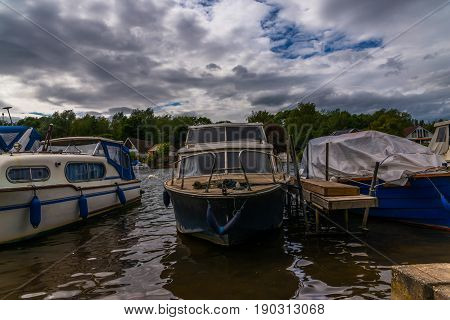Boats Anchored On The Bank Of The River, Residential Houses On The Other Side, Beautiful Broad River