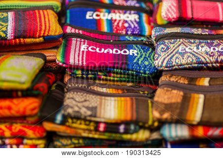 OTAVALO, ECUADOR - MAY 17, 2017: Beautiful andean traditional Pencil case textile yarn and woven by hand in wool, colorful fabrics background.