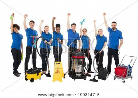 Group Of Happy Janitors With Cleaning Equipment Raising Their Arms