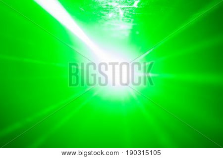 Laser beams are shining in the night club. Laser unit. Blurred abstract background