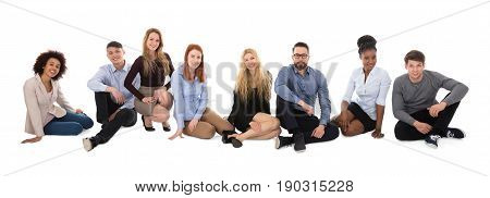 Portrait Of Happy Multiracial College Students Sitting On White Background