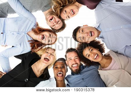 Low Angle View Of Happy Multiracial College Students Forming Huddle