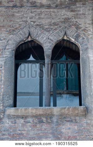 27 may 2017-vittorio veneto-Windows of a historic palace in the city of vittorio veneto