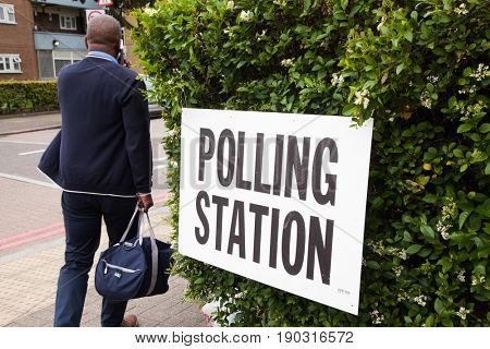LONDON, UNITED KINGDOM - JUNE 8, 2017: Unidentified citizens going to vote at a polling station during the British general elections in South London, United Kingdom on June 8, 2017.
