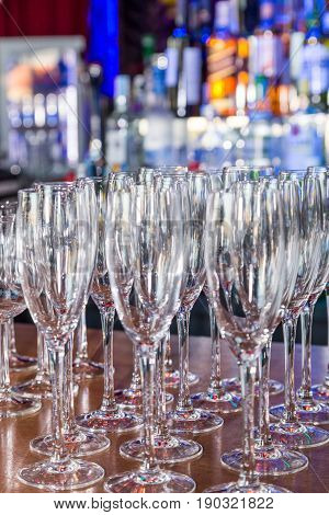 Empty Wine Glasses With Color Blur Background In Bar