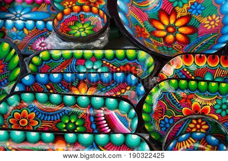 OTAVALO, ECUADOR - MAY 17, 2017: Beautiful Andean traditional Crafts made of clay, colorful crafts background
